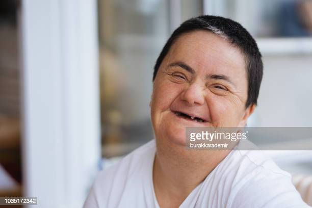 woman with down syndrome smiling - down syndrome stock pictures, royalty-free photos & images