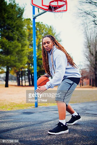 Woman with dreadlocks on basketball court