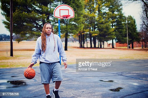 Woman with dreadlocks on basketball court