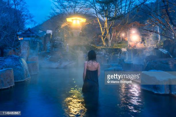 woman with dressing gown in a japanese onsen at dusk - 宿屋 ストックフォトと画像