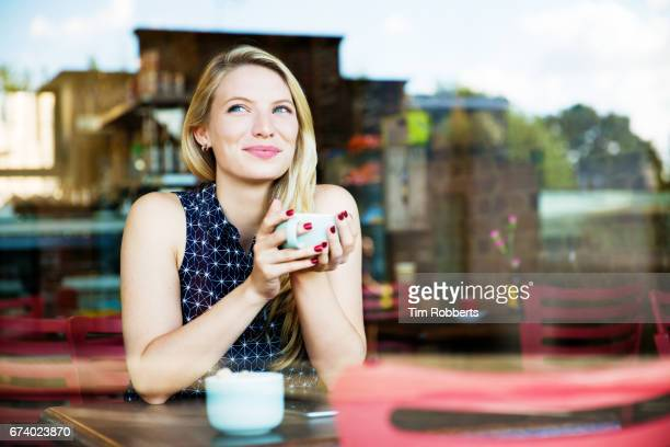 Woman with drink in coffee shop