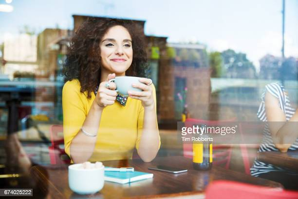 woman with drink in coffee shop - escaping stock pictures, royalty-free photos & images