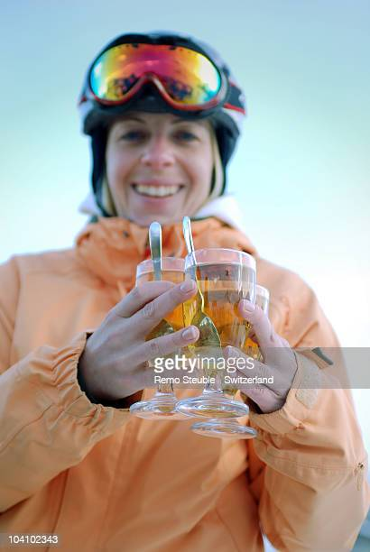 Woman with drinks at apres ski in St. Moritz.