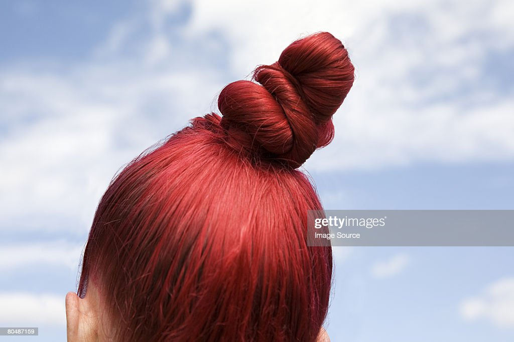 Woman with dyed red hair : Stock Photo