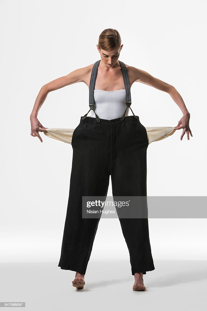 woman with empty pockets : Stock Photo