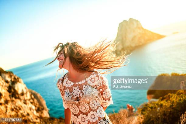 woman with es vedra in the background, ibiza, spain. - balearic islands stock pictures, royalty-free photos & images