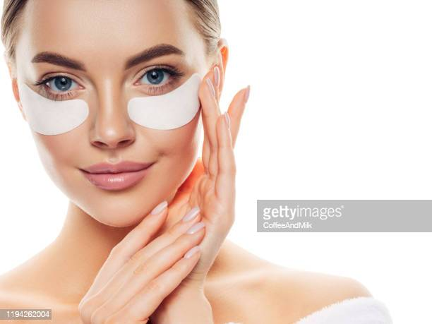 woman with eye patches under her eyes - cloth face mask stock pictures, royalty-free photos & images