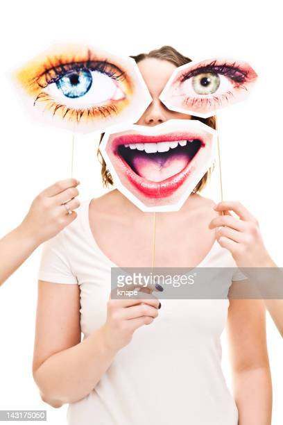 woman with eyes and smile signs infront of her - big eyes stock photos and pictures