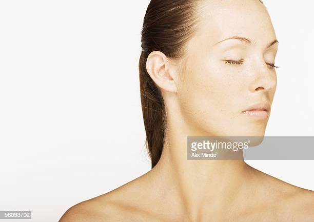 Woman with eyes closed and bare shoulders