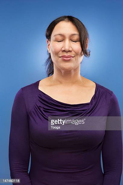 Woman with eyes closed and smiling