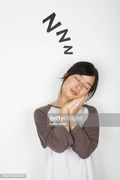 Woman with eyes closed and zz's above her head