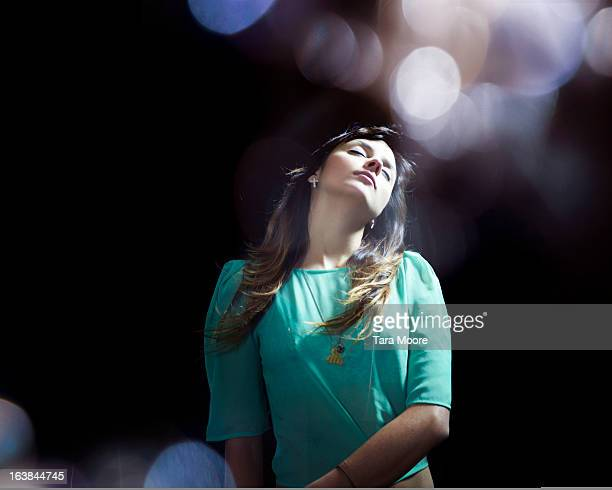 woman with eyes closed dreaming at night