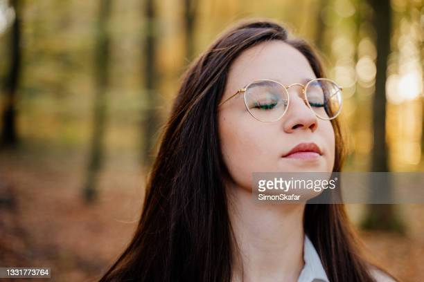 woman with eyes closed in forest - moment of silence stock pictures, royalty-free photos & images