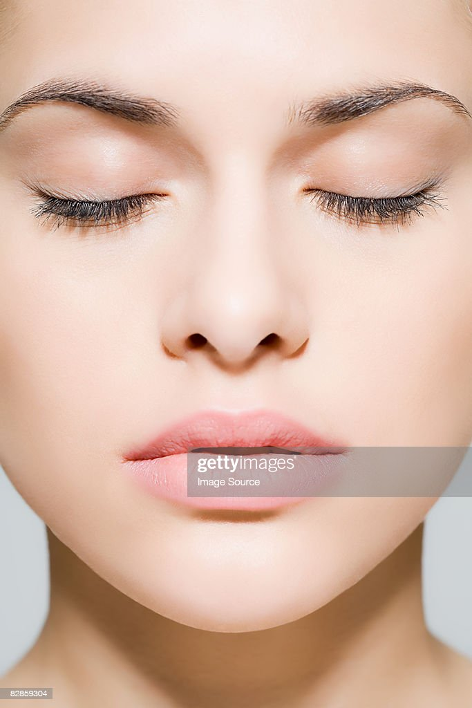 Woman With Eyes Closed High-Res Stock Photo - Getty Images