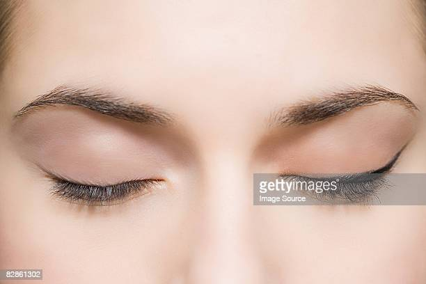 woman with eyes closed - eye liner stock pictures, royalty-free photos & images