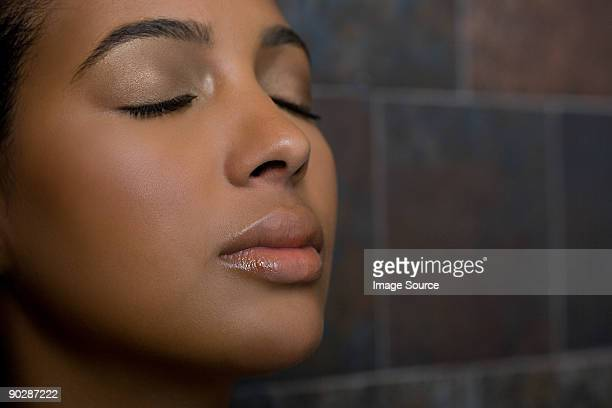 woman with eyes closed - black woman in sauna stock pictures, royalty-free photos & images