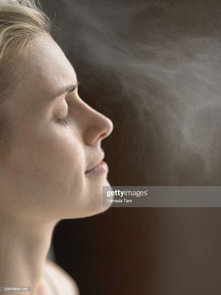Woman with eyes closed, side view : Stock Photo