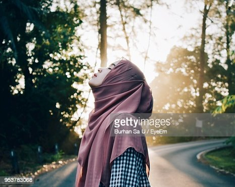 Woman With Eyes Closed Standing On Road
