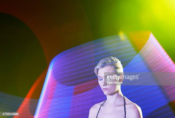 woman with eyes closed surrounded by light