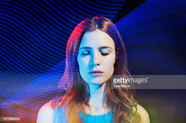 woman with eyes closed with light trails - light natural phenomenon ストックフォトと画像