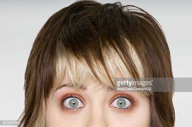 woman with eyes wide open - bug eyes stock photos and pictures