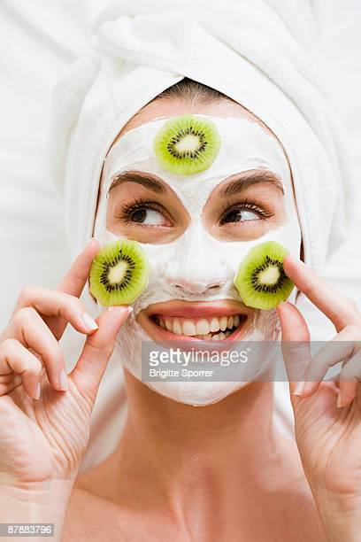 woman with face mask and kiwi fruit - massage funny stock pictures, royalty-free photos & images