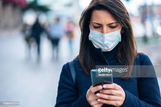 woman with face protective mask - iphone stock pictures, royalty-free photos & images