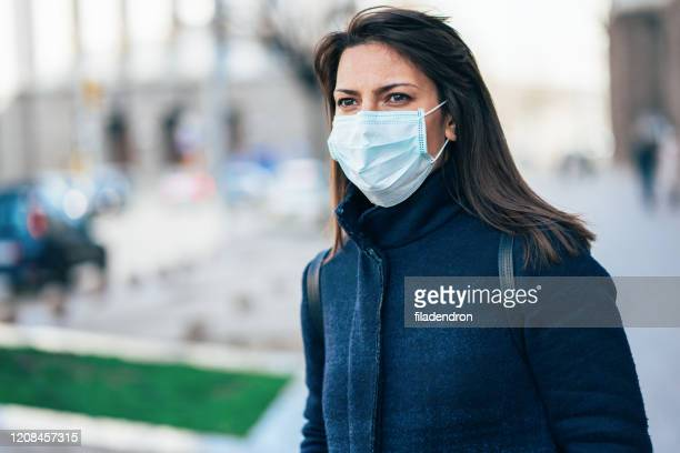woman with face protective mask - respirator mask stock pictures, royalty-free photos & images