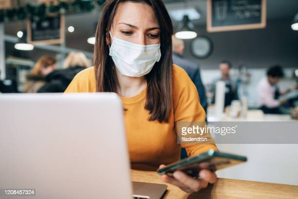 woman with face protective mask - covid 19 stock pictures, royalty-free photos & images