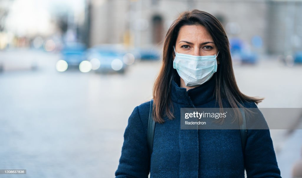 Woman with face protective mask : Stock Photo