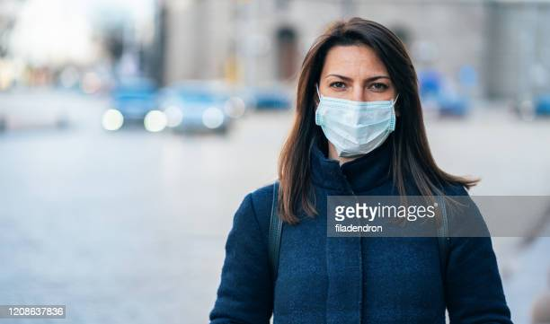 woman with face protective mask - face masks imagens e fotografias de stock