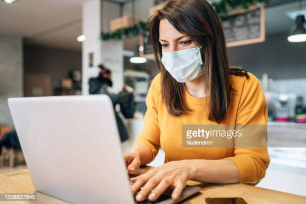 woman with face protective mask - coronavirus stock pictures, royalty-free photos & images