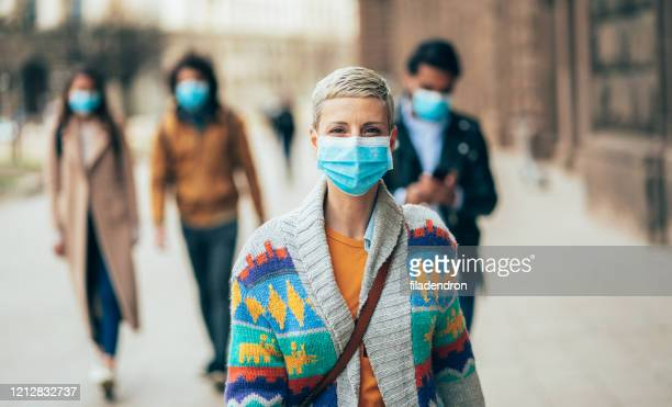 woman with face protective mask - protective face mask stock pictures, royalty-free photos & images