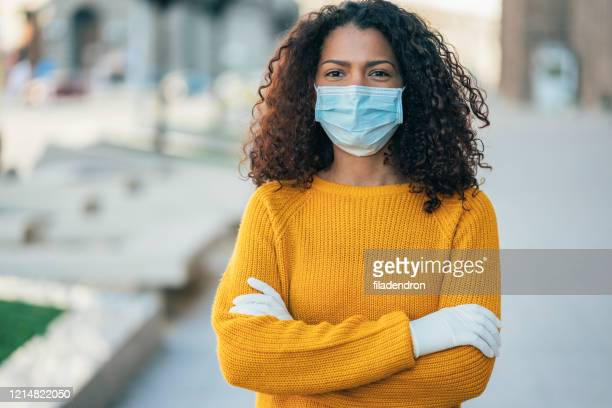 woman with face protective mask - black glove stock pictures, royalty-free photos & images
