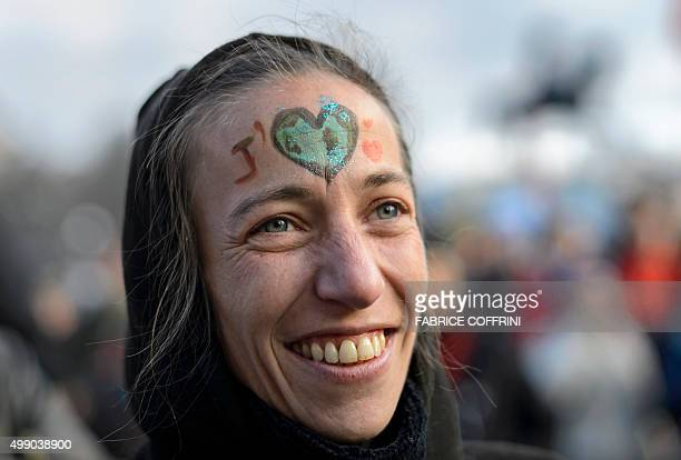 A woman with facepaint looks on on November 28 2015 in Geneva during a rally ahead of the UN climate summit COP21 Protesters joined a worldwide wave...