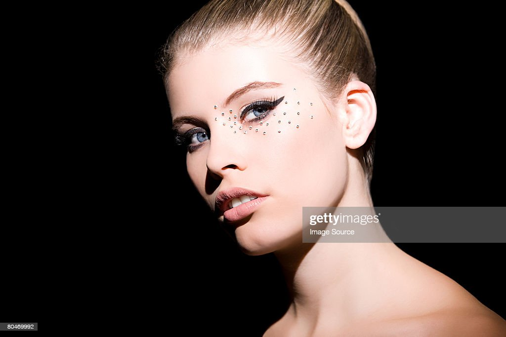 Woman with facial decoration : Stock Photo