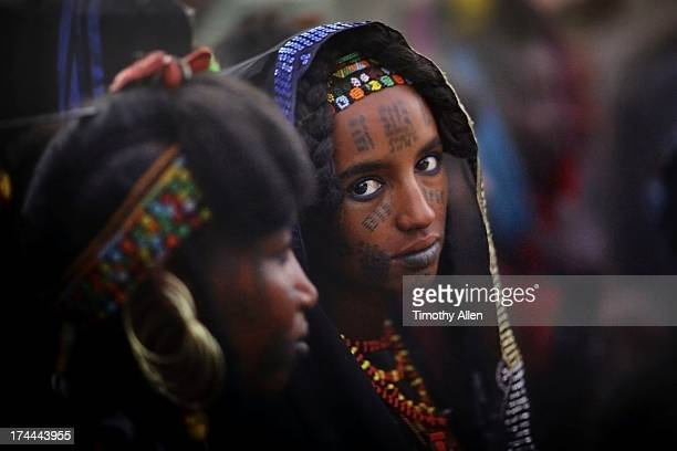Woman with facial scar tatoos and tribal jewelry