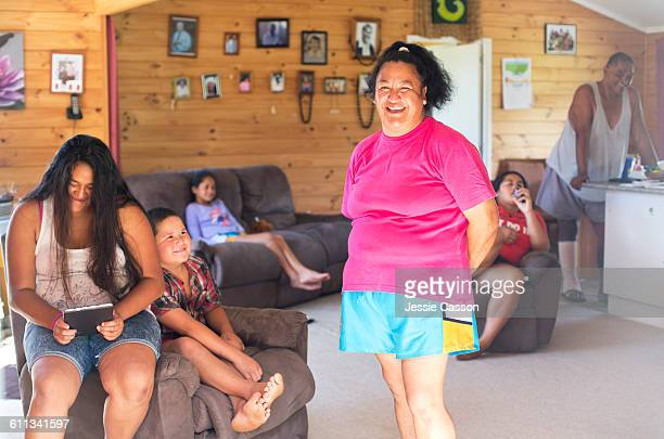 MAORI woman with family at home