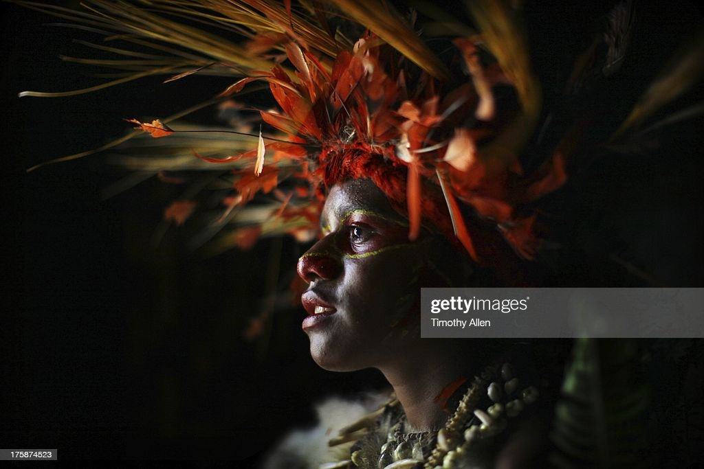 Woman With Feather And Grass Headdress High-Res Stock