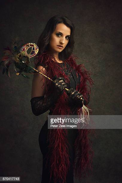 Woman with feather boa and mask