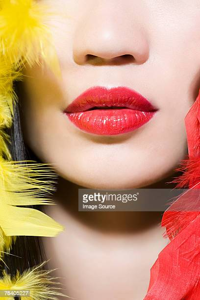Woman with feathers around her face