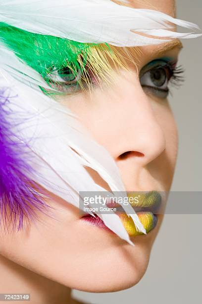 Woman with feathers on her face
