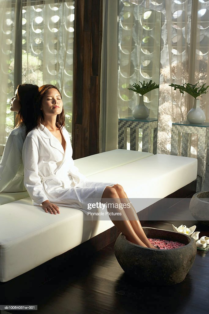 Woman with feet in washtub in health spa : Stock Photo