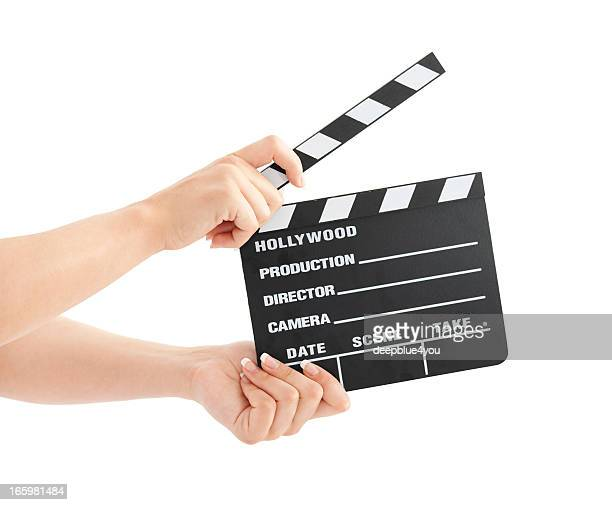 woman with film clapper on white background - actor stockfoto's en -beelden