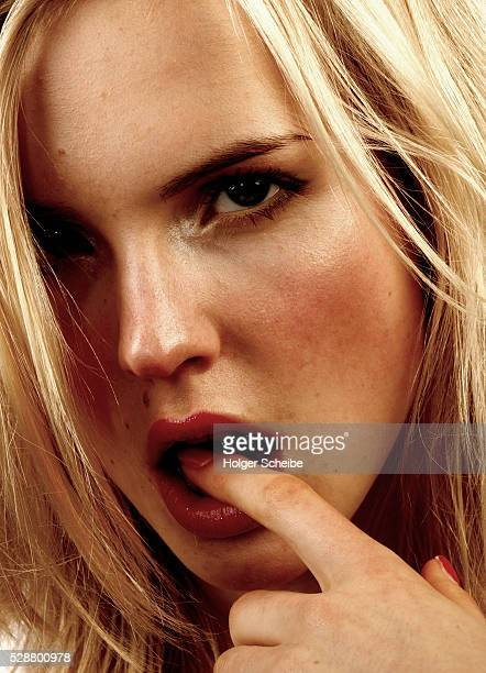 Woman with finger in mouth