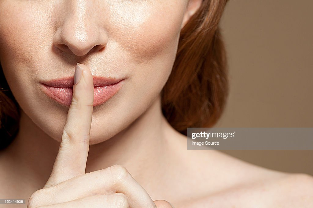 Woman With Finger On Lips Close Up Stock Photo  Getty Images-7420