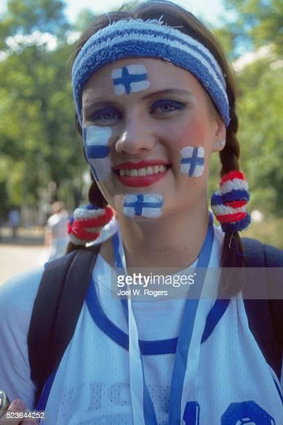 woman with finnish flags on her face - finsk flagga bildbanksfoton och bilder