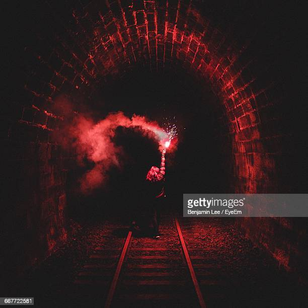 Woman With Flaming Torch In Tunnel