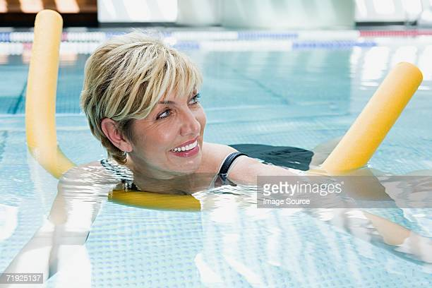 Woman with float in swimming pool