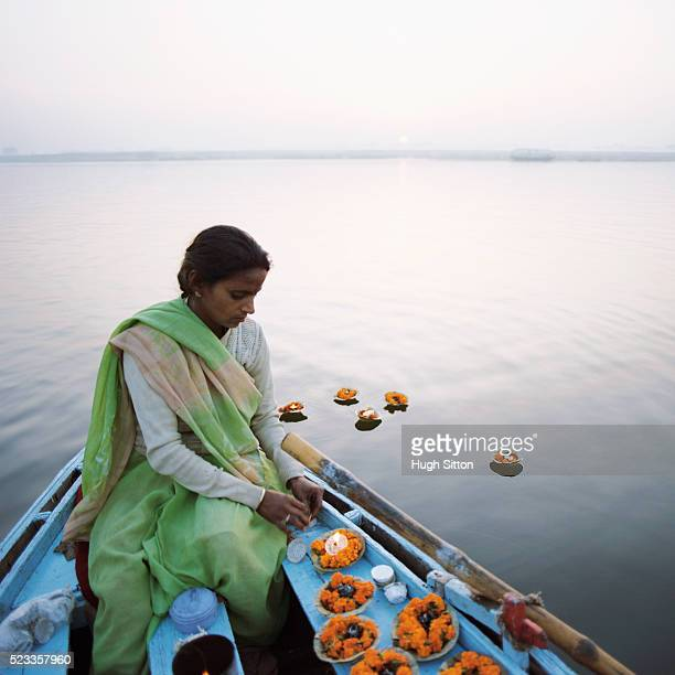 woman with floating wishing candles - hugh sitton india stock pictures, royalty-free photos & images